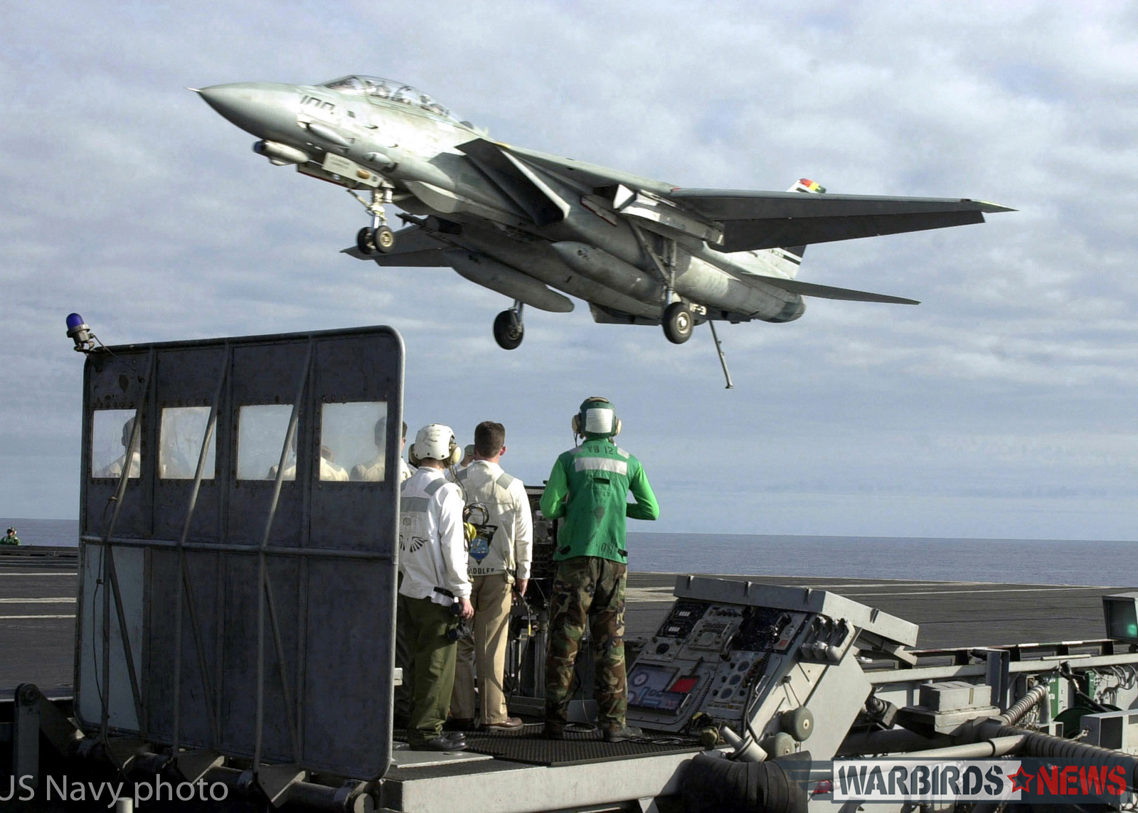"""Aboard USS Abraham Lincoln (Jan. 26, 2001) -- An F-14D """"Tomcat"""" from the """"Tomcatters"""" of Fighter Squadron Three One (VF-31) flies over the Landing Signal Officer (LSO) platform aboard USS Abraham Lincoln (CVN 72) after returning from a successful proficiency flight. The Lincoln is on her final leg of a scheduled six-month deployment to the Arabian Gulf in support of Operation Southern Watch. U.S. Navy photo by Photographer's Mate 2nd Class Daniel Wolsey. (RELEASED)"""