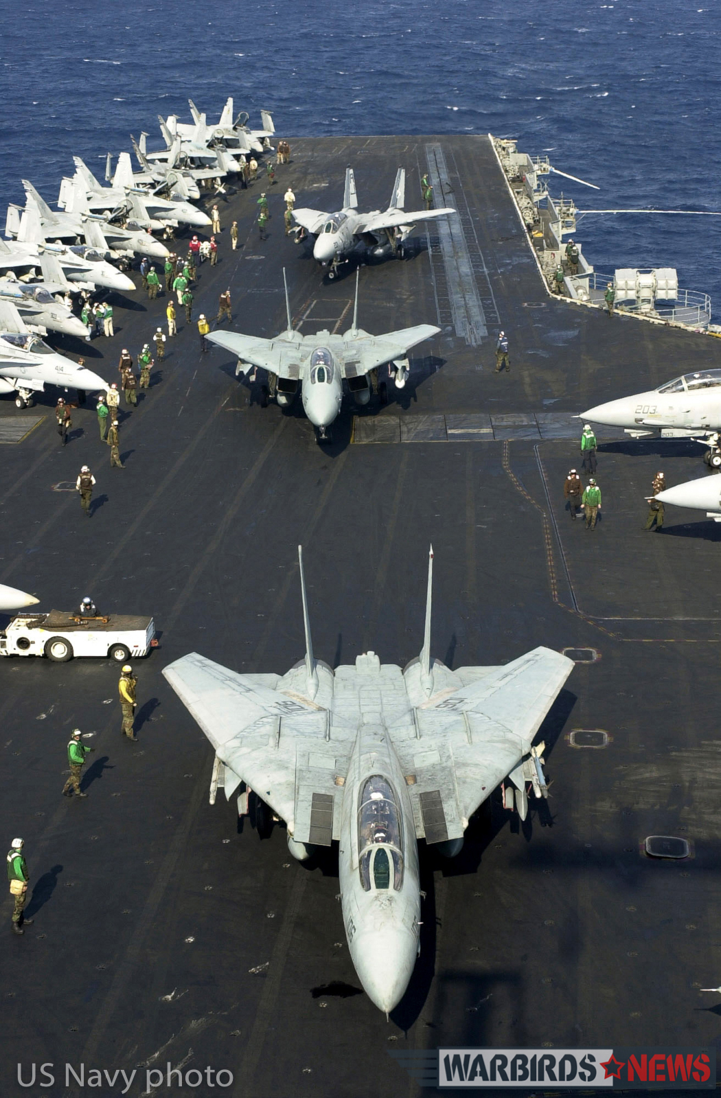 Aboard USS Enterprise (CVN 65) Nov 9, 2001-- F-14 Tomcats prepare to take off from the flight deck of USS Enterprise a final time. This was the last time the 34 year-old aircraft will be deploying on the carrier. USS Enterprise (CVN 65) is returning to her homeport in Norfolk, Virginia after completing a six-month deployment. U.S. Navy Photo by Photographer's Mate 1st Class, Martin Maddock. (RLEASED)