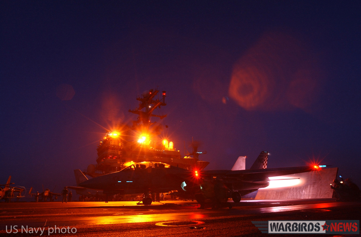 "At sea aboard USS John C. Stennis (CVN 74) Jan. 12, 2002 - An F-14 ""Tomcat"" from the ""Checkmates"" of Fighter Squadron Two One One (VF-211) ignites its afterburner seconds before a launch from the number three catapult. John C. Stennis and her embarked Carrier Air Wing Nine (CVW-9) continue to conduct bombing missions in support of Operation Enduring Freedom. U.S. Navy photo by Photographer's Mate 3rd Class (AW) Jayme Pastoric (REALEASED)"