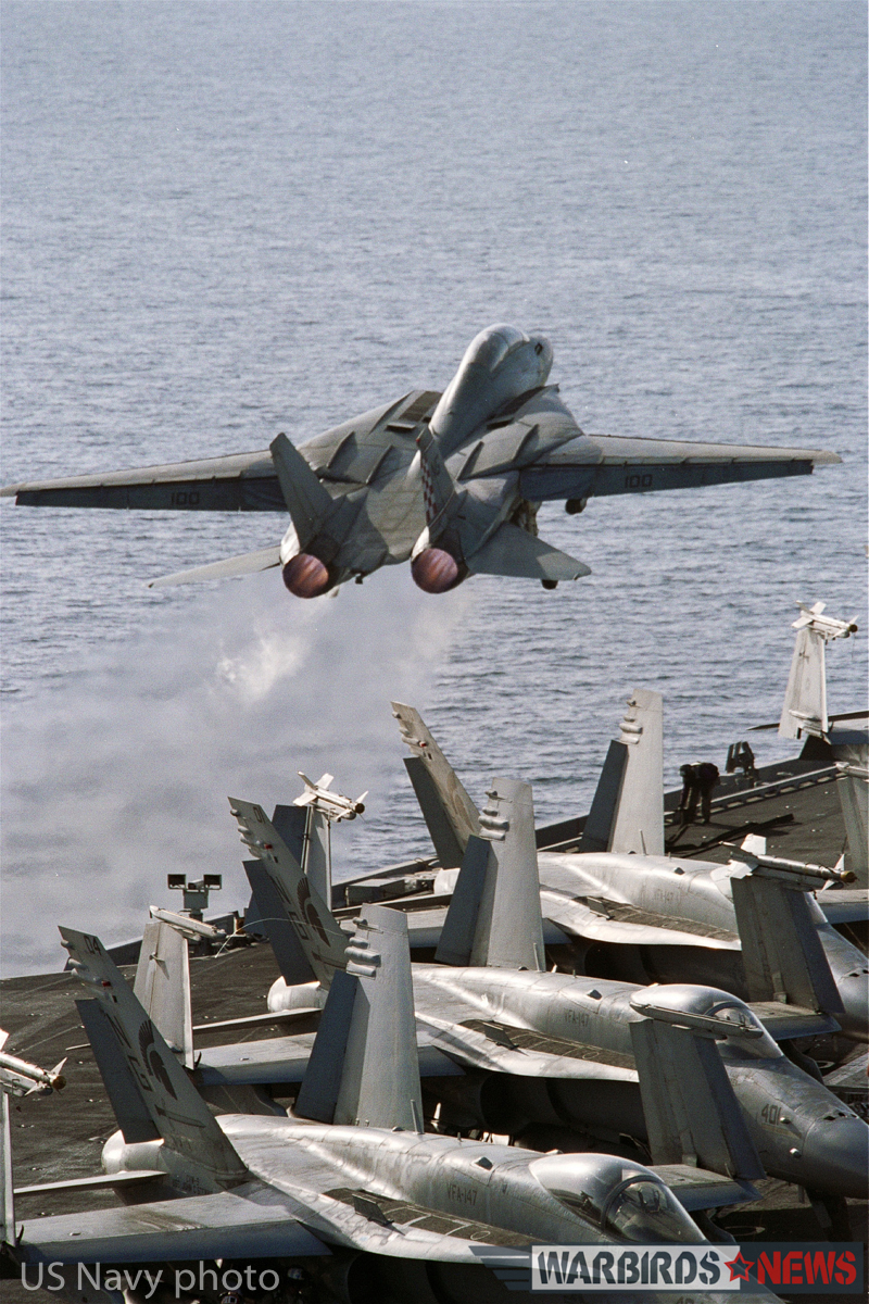 "At sea aboard USS John C. Stennis (CVN 74) Mar. 27, 2002 - An F-14A ""Tomcat"" from the ""Checkmates"" of Fighter Squadron Two One One (VF-211) launches off the flight deck. Carrier Air Wing Nine (CVW-9) and John C. Stennis are deployed in support of Operation Enduring Freedom. U.S. Navy photo by Photographer's Mate 3rd Class Jayme T. Pastoric. (RELEASED)"