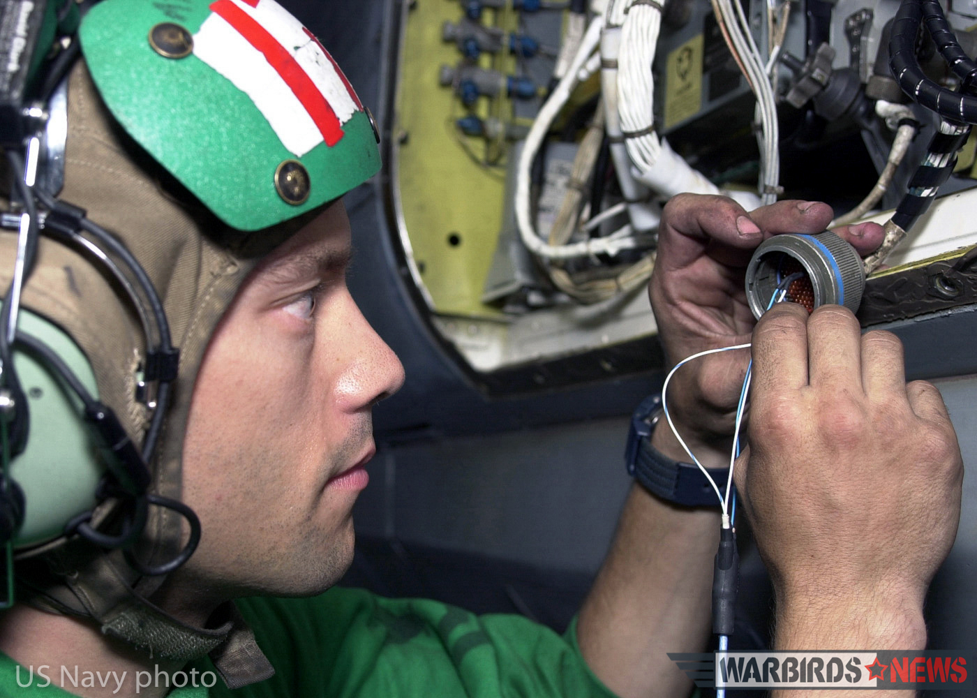 "At sea aboard USS Abraham Lincoln (Oct. 18, 2002) -- Aviation Electronic's Technician 2nd Class Tony Komljenovich from Cleveland, Ohio, assigned to Fighter Squadron Thirty-One (VF-31) troubleshoots the wires on a cannon plug of an F-14D ""Tomcat."" This maintenance is performed to ensure that the APG-71 radar system aboard the aircraft is working properly. The APG-71 radar is a digital processing system that gives the F-14D improved detection and tracking range. It features a low-sidelobe antenna, a sidelobe-blanking guard channel, and monopulse angle tracking, all of which are intended to make the radar less vulnerable to jamming. Lincoln and her embarked Carrier Air Wing Fourteen (CVW-14) are on a scheduled six month deployment conducting combat missions in support of Operation Enduring Freedom. U.S. Navy photo by Photographer's Mate 2nd Class Virginia K. Schaefer. (RELEASED)"