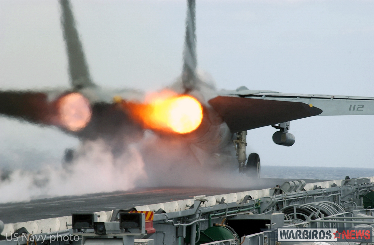 "At sea aboard USS Kitty Hawk (CV 63) Nov. 9, 2002 -- An F-14 ""Tomcat"" assigned to the ""Black Knights"" of Fighter Squadron One Five Four (VF-154) ignites its afterburners during a launch from one of four steam driven catapults on the ship's flight deck. Kitty Hawk is the Navy's only permanently forward-deployed aircraft carrier and operates out of Yokosuka, Japan. U.S. Navy photo by Photographer's Mate 3rd Class Todd Frantom. (RELEASED)"