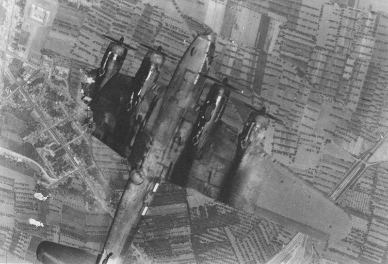 A B-17 Flying Fortress goes down with its ten man crew over occupied Europe following a direct hit from a German flak battery. (photo US Army Air Force)