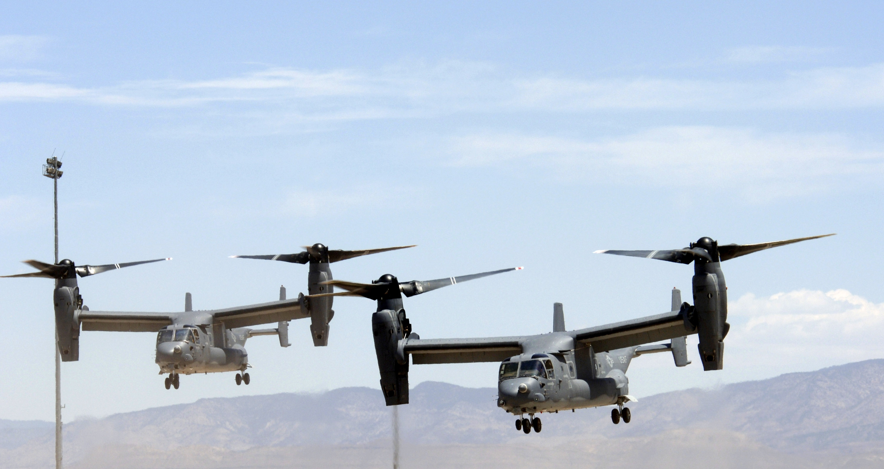 "Two Air Force CV-22 Ospreys prepare to land at Holloman Air Force Base, N.M., on Friday, May 26, 2006. These Osprey are two of only three in the Air Force inventory. The Ospreys and their crews are taking part in the filming of the movie, ""Transformers."" (U.S. Air Force photo/Airman 1st Class Russell Scalf)"