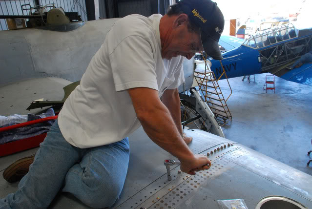 Bolting the right hand outer wing panel in place for the final time - Jul.2011 - Dan Newcomb photo