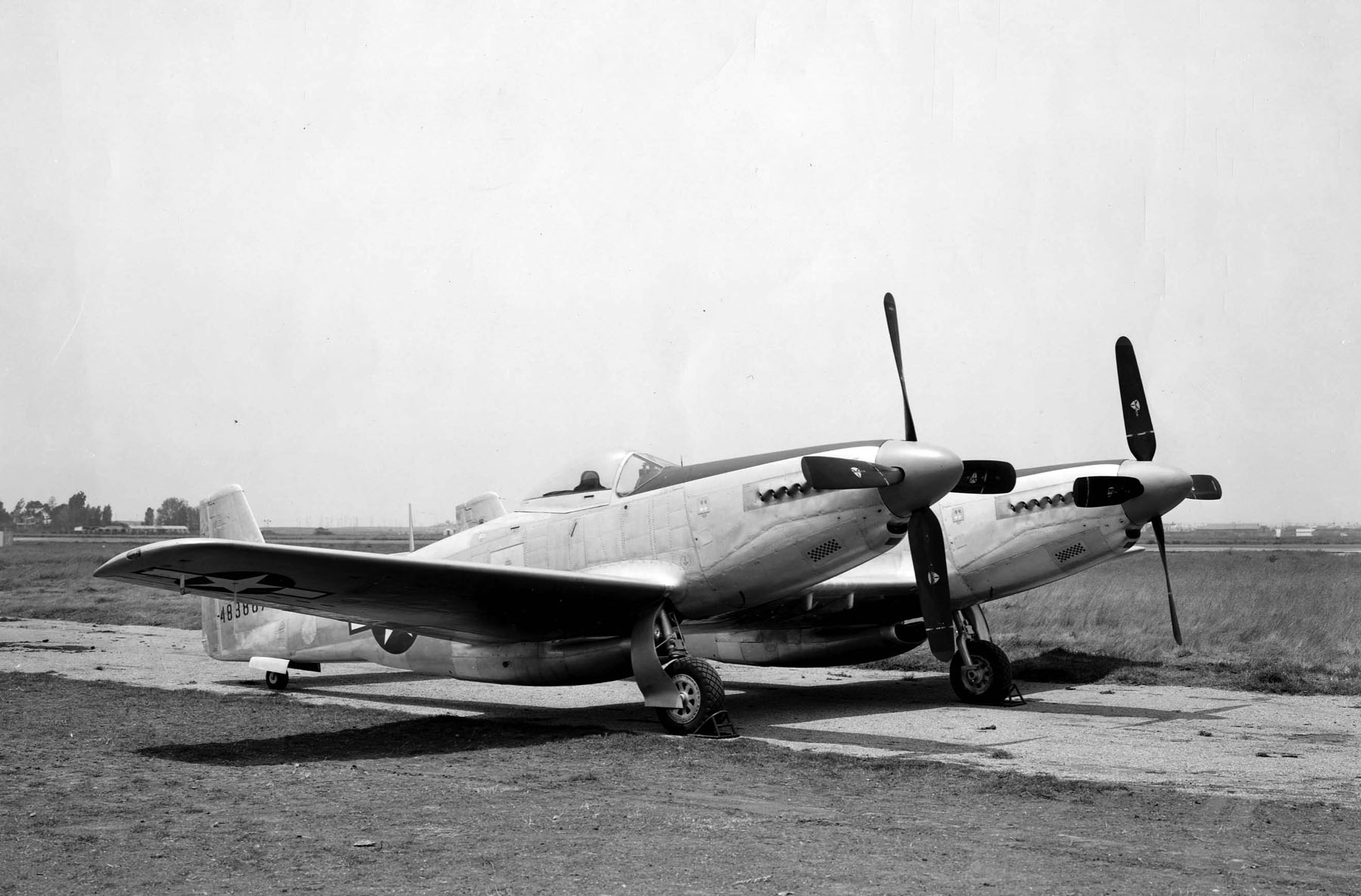 A picture of #44-83887 prior to its first flight with the left-hand turner on the left-hand fuselage and the right-hand turner on the right-hand fuselage with upsweeping props. This propeller configuration is what created the unacceptable stall situation during the initial test flight. (photo via Tom Reilly)