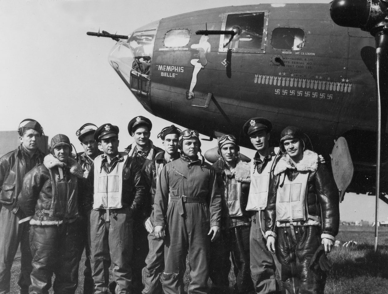 "The crew of the ""Memphis Belle""® after their 25th mission: (l to r) TSgt. Harold Loch (top turret gunner/engineer), SSg.t Cecil Scott (ball turret gunner), TSgt. Robert Hanson (radio operator), Capt. James Verinis (copilot), Capt. Robert Morgan (pilot), Capt. Charles Leighton (navigator), SSgt. John Quinlan (tail gunner), SSgt. Casimer Nastal (waist gunner), Capt. Vincent Evans (bombardier), and SSgt. Clarence Winchell (waist gunner). (U.S. Air Force photo) Gen. Hap Arnold, commander of the U.S. Army Air Forces, examining the ""Mempis Belle"" after it returned to the United States. (U.S. Air Force photo)"