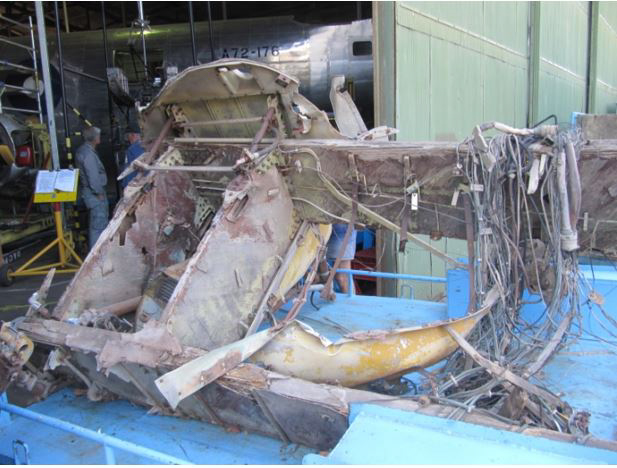 The wing center section from a wrecked Oxford seen soon after it had arrived via donation from South Australia. This item provided many useful original (small) parts, templates and details for the project. (photo via B-24 Liberator Memorial Fund)