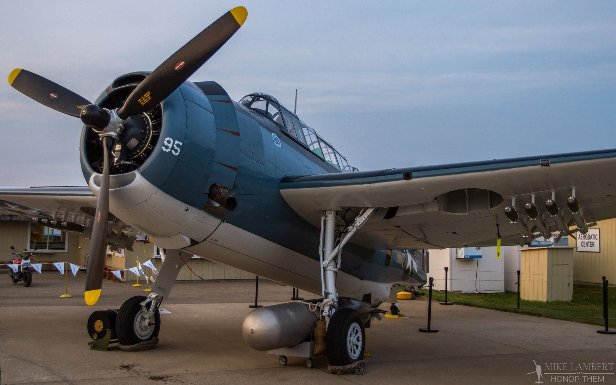 Lake Erie Warbirds' TBM-3E in the evening light at EAA AirVenture 2014. (photo by Mike Lambert) Photograph by Mike Lambert