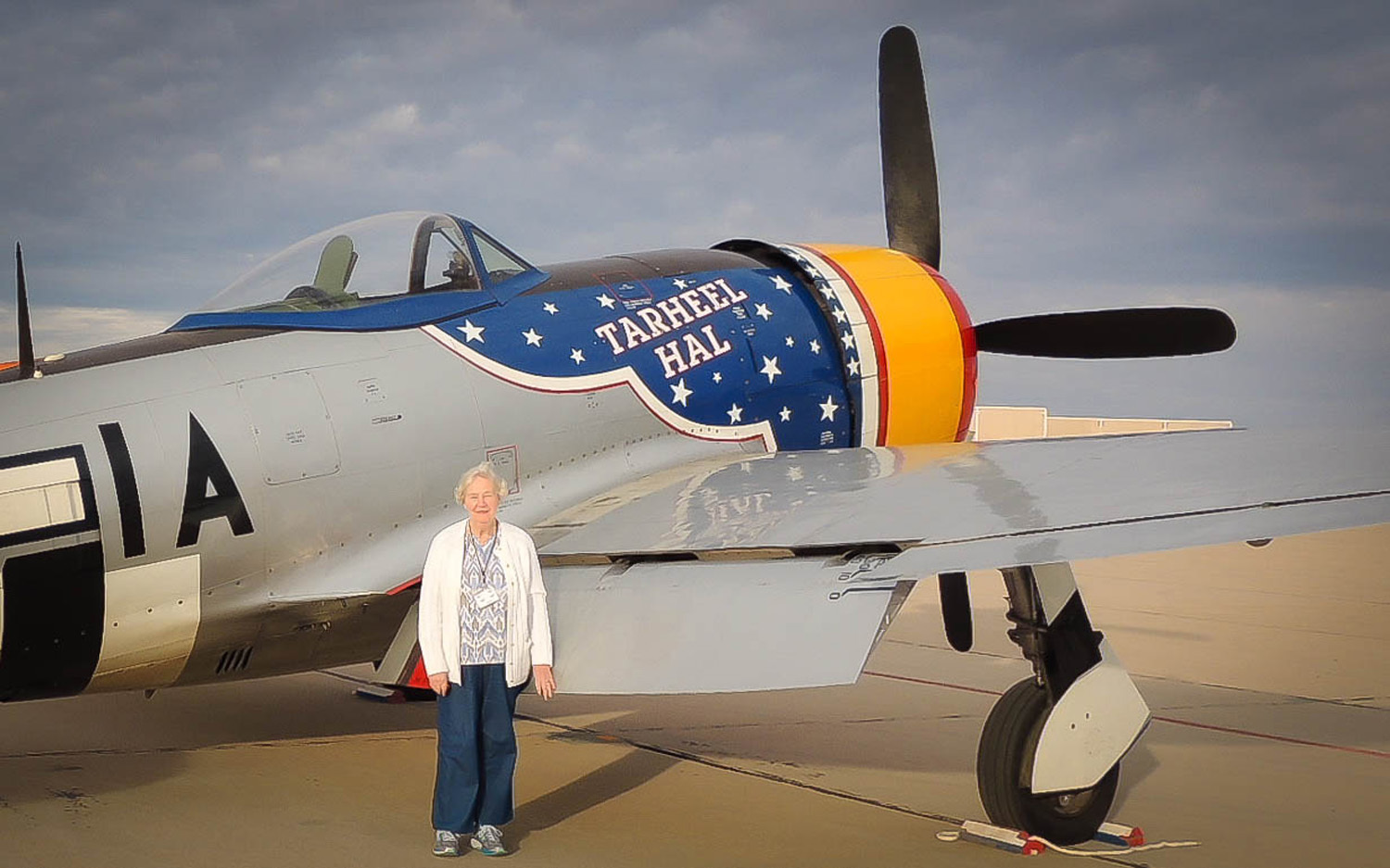 Victoria Thomson stands next to a P-47 Thunderbolt before an Air Force Heritage Flight demonstration on March 6, 2016 at Davis-Monthan Air Force Base, Ariz. Thomson's father, Capt. Carl Ekstrom, was killed during World War II while piloting a P-47. After nearly seven decades, Thomson finally came face-to face with the Thunderbolt. (Courtesy photo)