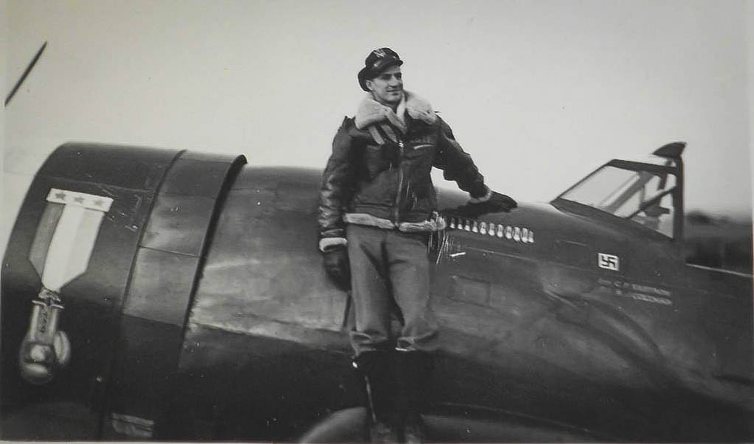 Capt. Carl Ekstrom poses with his battle tested P-47 Thunderbolt. Ekstrom was a two-time Golden Glove boxer which was signified by the distinct mural on his aircraft. Ekstrom was shot down over France while piloting a P-47 Thunderbolt following a bomber escort mission. (Courtesy Photo)
