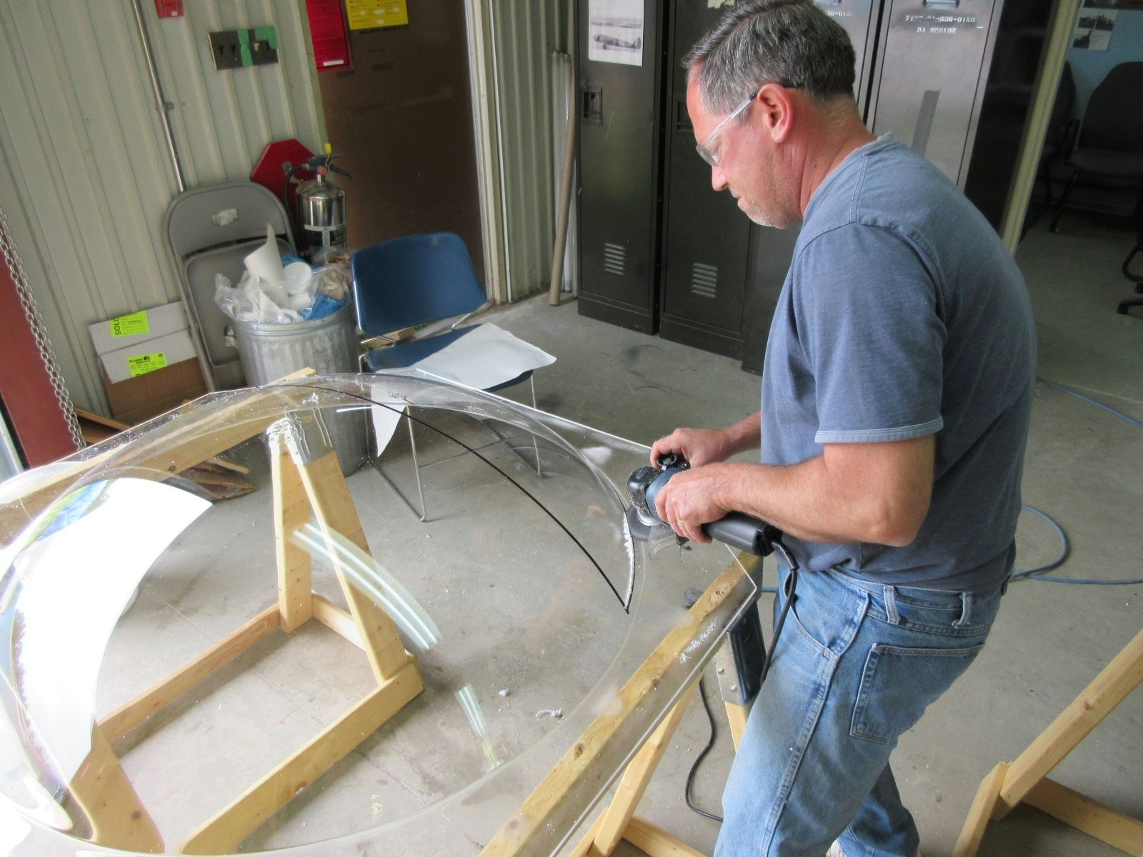 Dave Saulnier cutting the glazing panels from the freshly blown Plexiglas. (photo by Malcolm Uhlman)