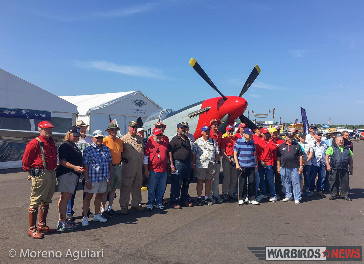 US combat veterans and CAF volunteers gather for a photo in front of the CAF's first Mustang, known the world over as 'Old Red Nose'. (photo by Moreno Aguiari)