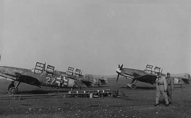 A wartime shot of Messerschmitt Bf 109 G-12s at a German airfield. Many thanks to reader Mark Eaton for sending in this shot! (Luftwaffe photo)