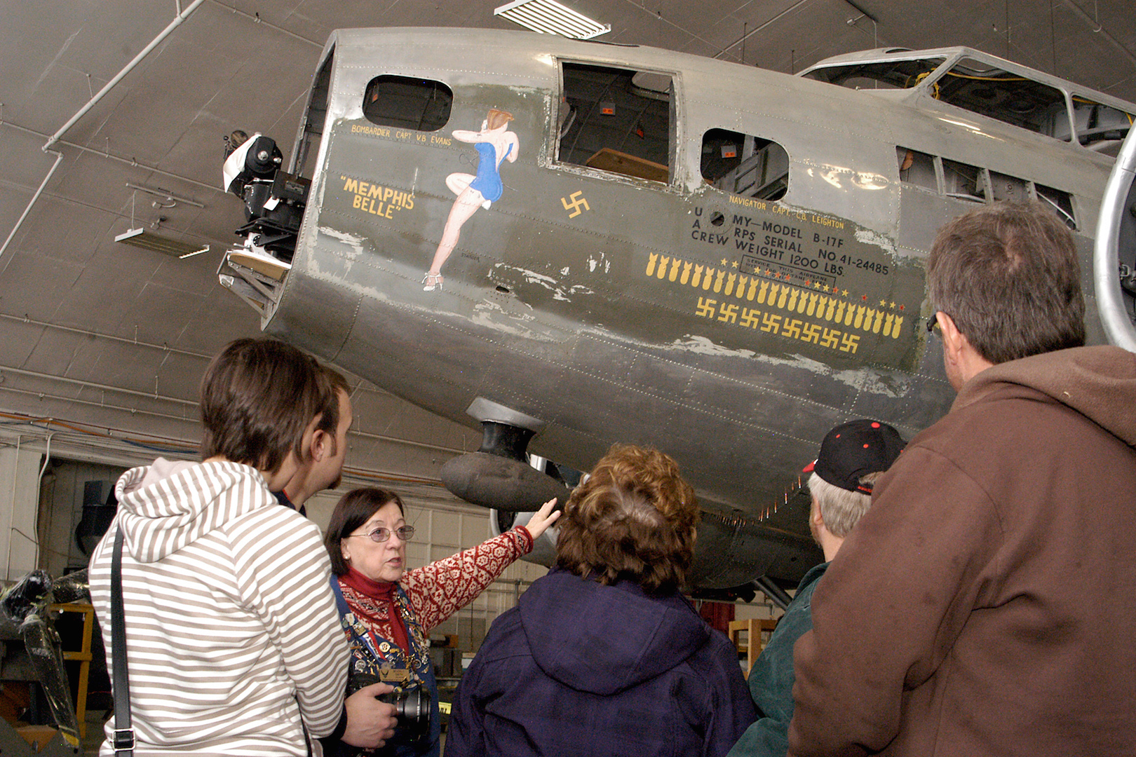 Museum volunteer Beverly Smith walks visitors through the Behind the Scenes Tour of the restoration area. The Memphis Belle is one of the restoration projects that visitors can view. (U.S. Air Force photo by Ken LaRock)