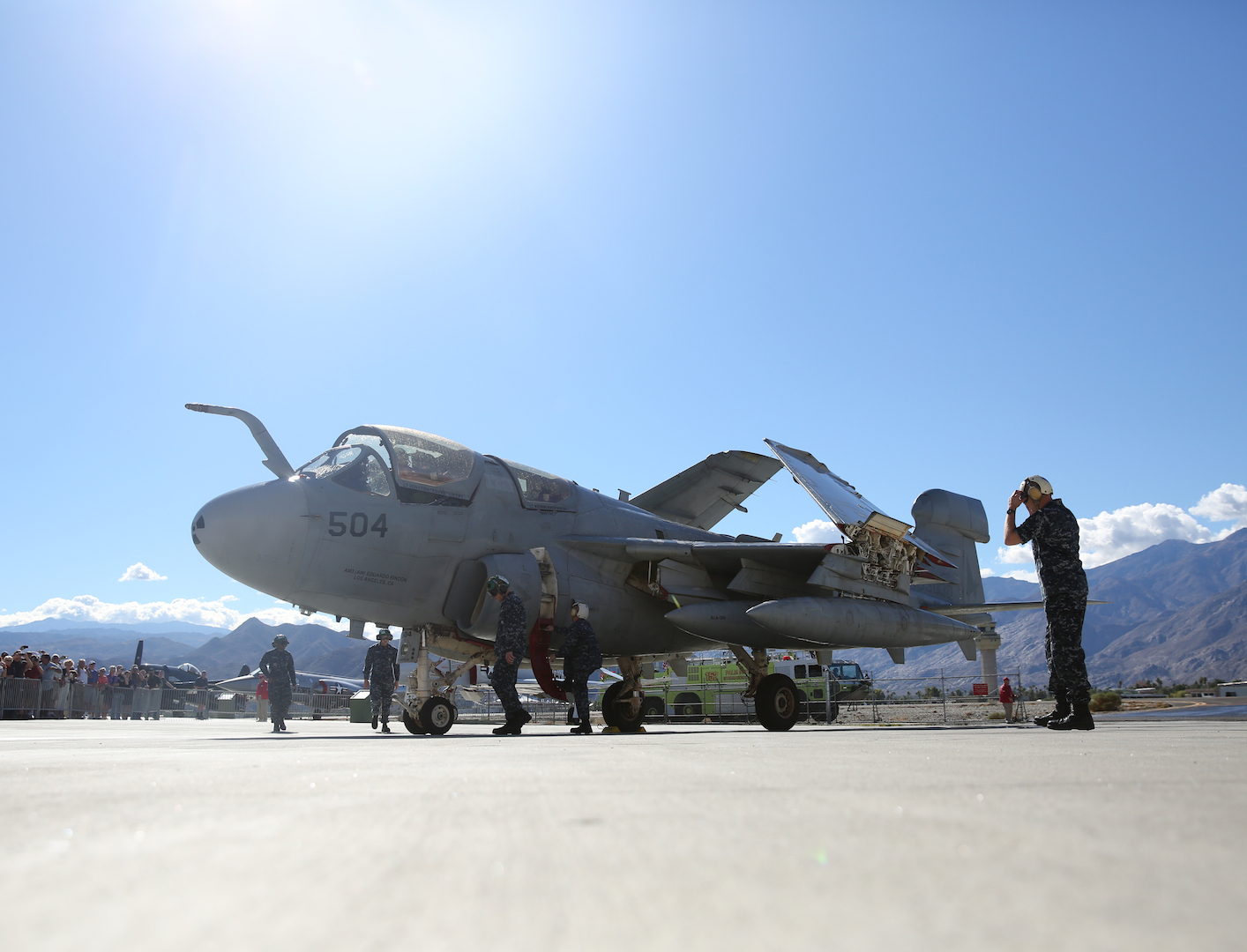 Navy Maintenance team performs post-flight checks on the EA-6B 'Prowler' fixed-wing aircraft after it lands for its retirement ceremony at the Palm Springs Air Museum, Nov. 21, 2014. The aircraft was retired after more than 20 years serving the U.S. Navy and will be put on display at the museum. (Official Marine Corps Photo by Lance Cpl. Julio McGraw/Released)