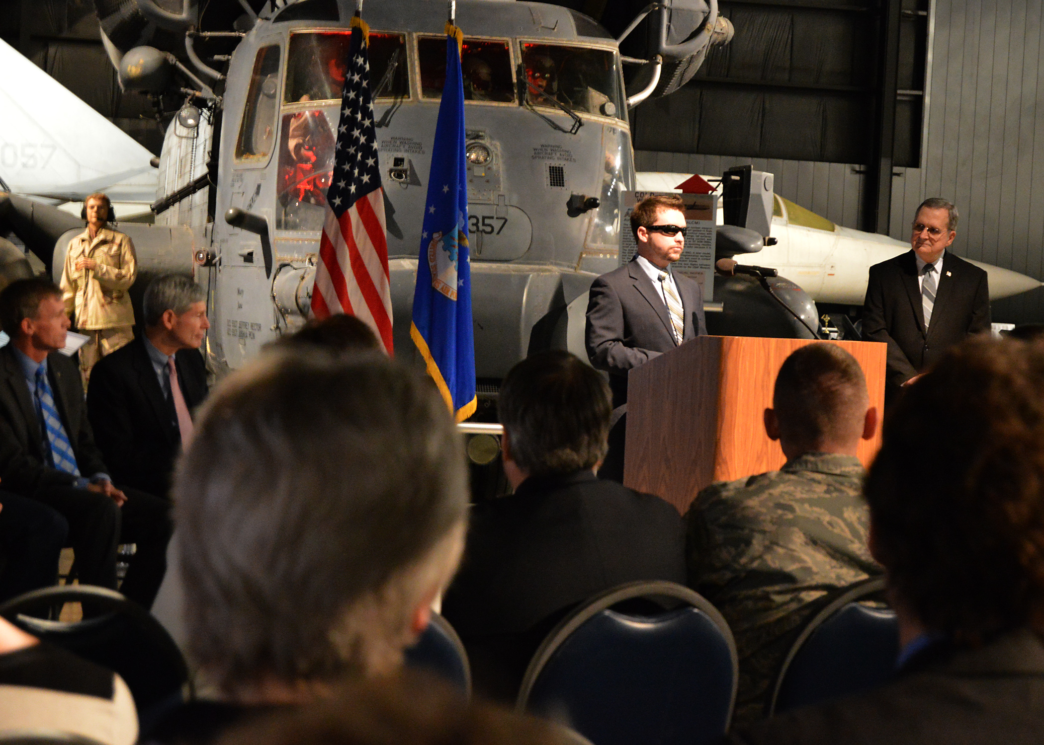 "SSgt.(Ret.) Mike Malarsie speaks at the ""Duty First, Always Ready"" exhibit opening on Jan. 23, 2015 in the Cold War Gallery at the National Museum of the U.S. Air Force. (U.S. Air Force photo)"