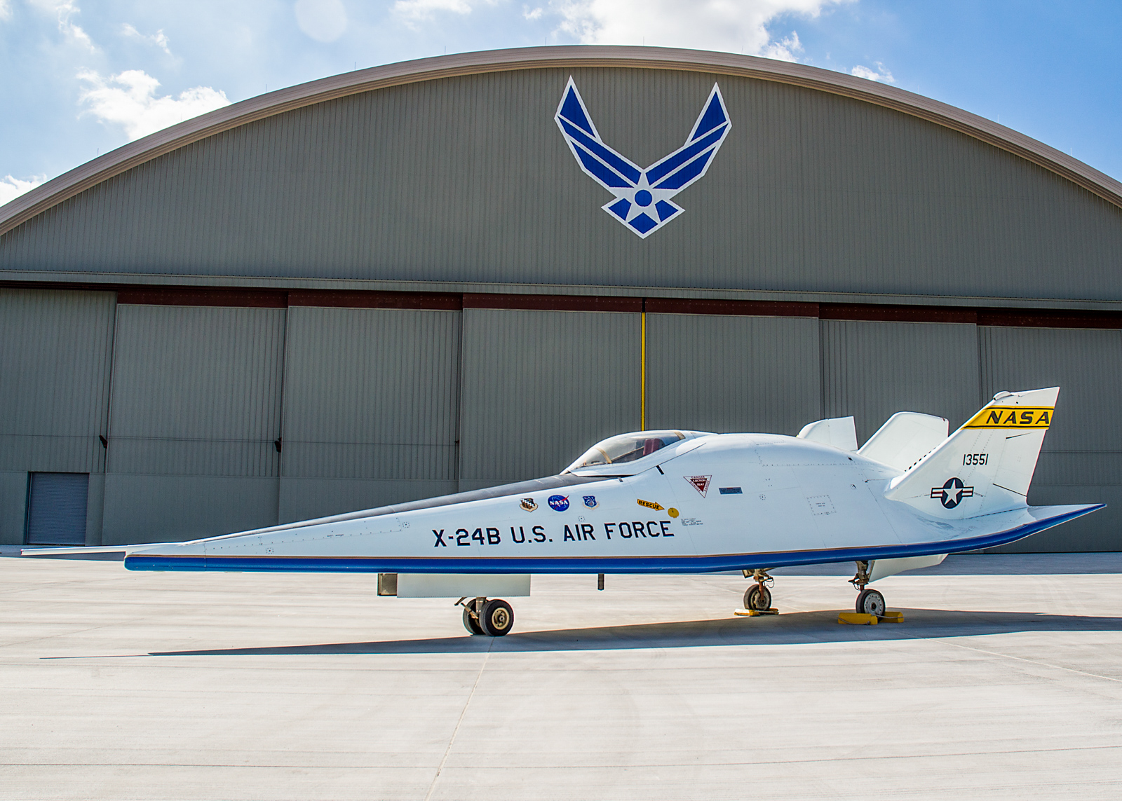 The Martin X-24B in front of  the new fourth building at the National Museum of the U.S. Air Force on Oct. 14, 2015. The X-24B started life as the radically different X-24A as represented in the image above. (U.S. Air Force photo by Ken LaRock)