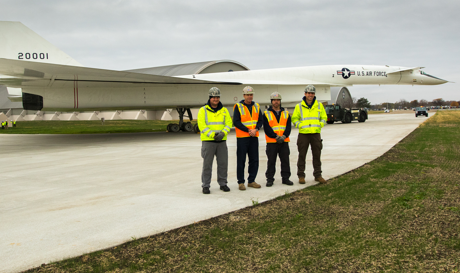 Some of the museum restoration staff pose in front of the freshly-cleaned XB-70 Valkyrie. (NMUSAF photo by Don Popp)