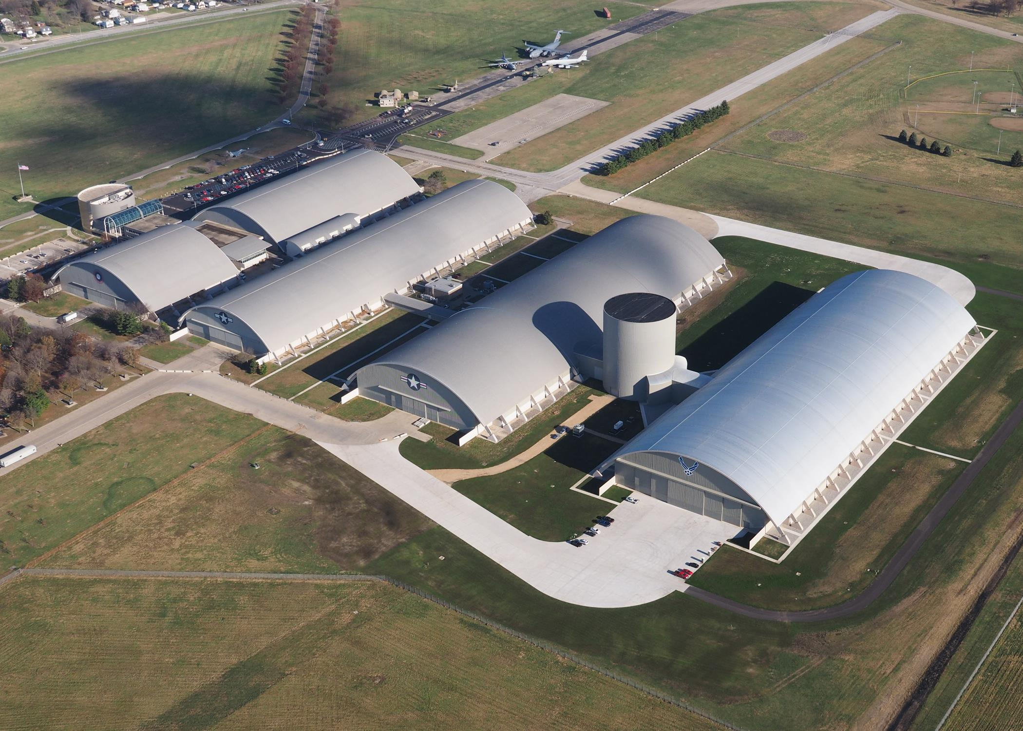 Aerial view of the National Museum of the U.S. Air Force during construction of the museum's fourth building on Nov. 13, 2015. The 224,000 square foot building, which is scheduled to open to the public in June of 2016, is being privately financed by the Air Force Museum Foundation, a non-profit organization chartered to assist in the development and expansion of the museum's facilities. (Photo courtesy of McKenrick Lee Photography)
