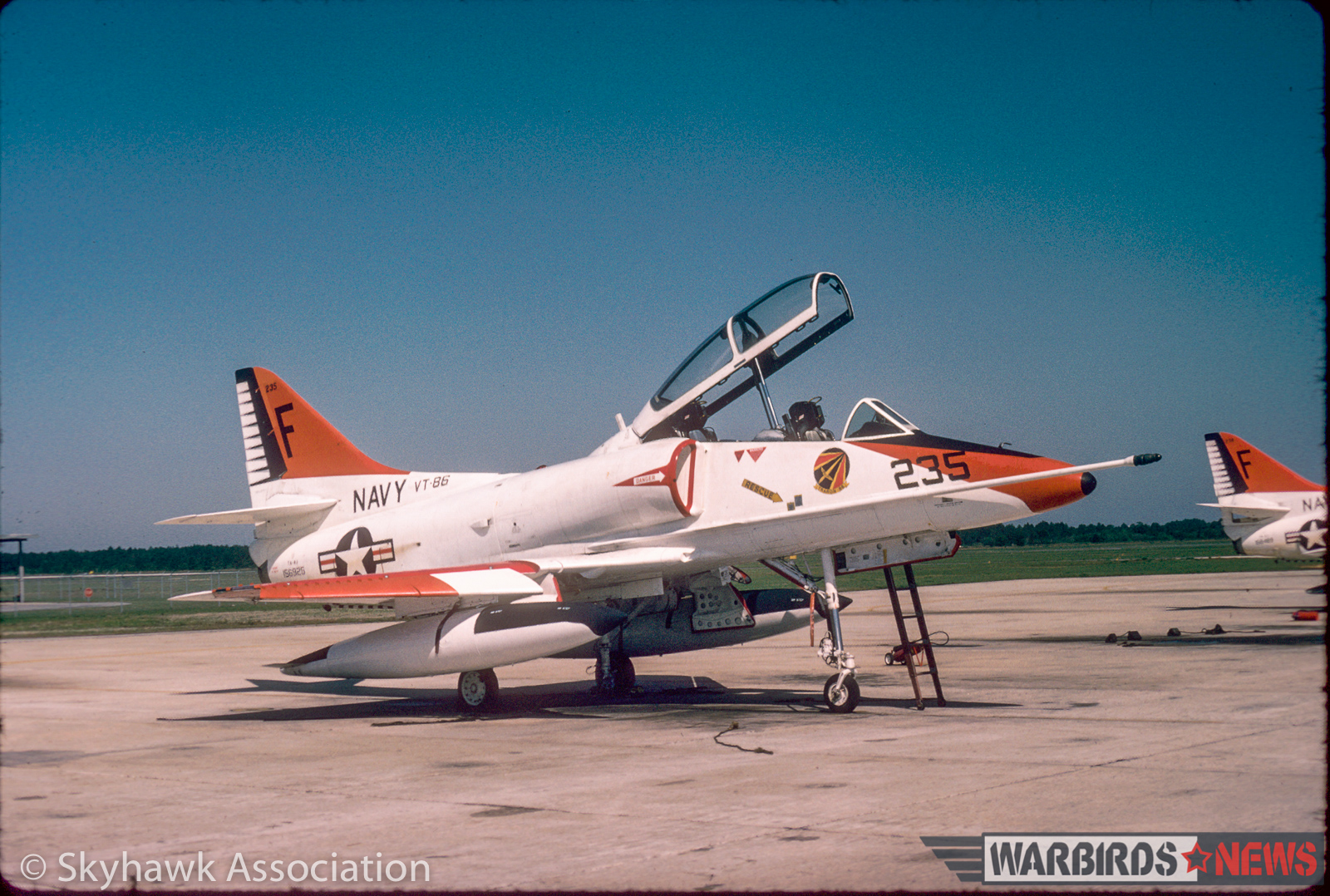 Right front view of VT-86 Sabrehawks TA-4J Skyhawk BuNo 156925 F-235, on the flightline, NAS Pensacola, 21 April 1978.