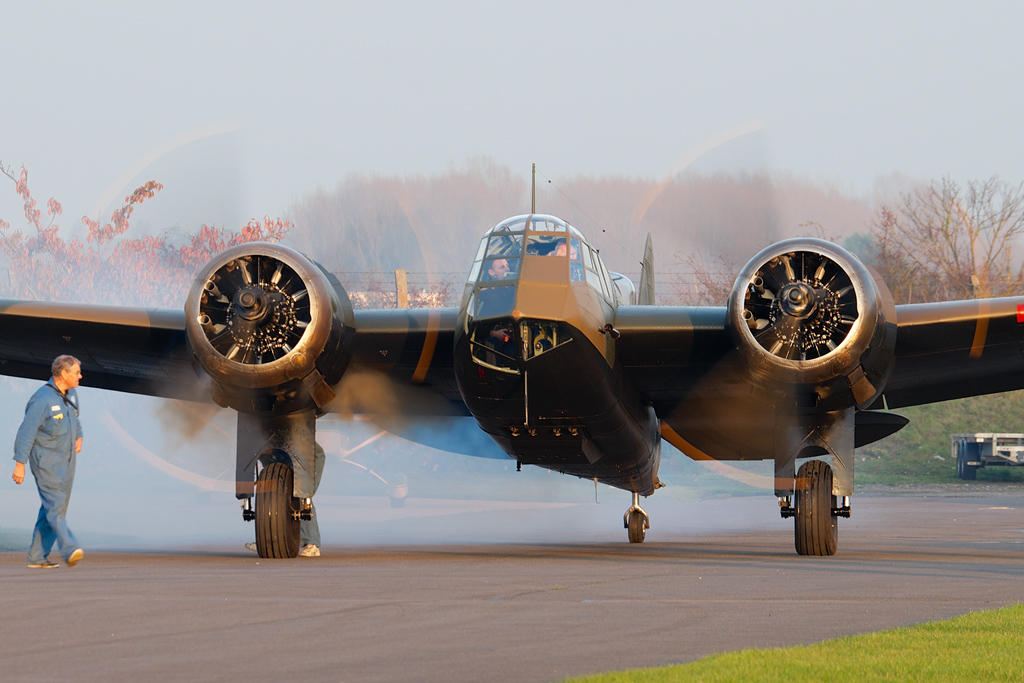 John Romain starts the Blenheim's Bristol Mercurys in the typical cloud of smoke produced by every radial engine. (photo by George Land via Global Aviation Resource)