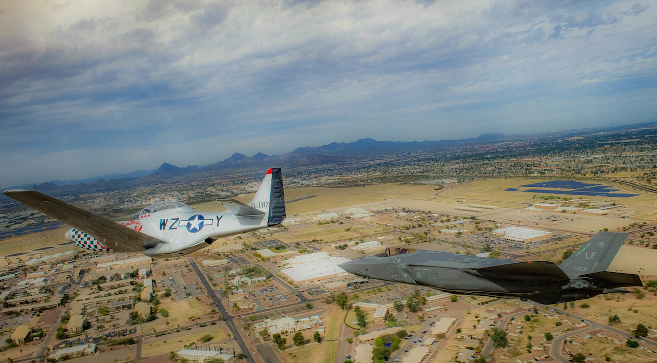 A P-51 Mustang and an F-35 Lightening II fly around the airspace of Davis-Monthan Air Force Base on March 4, 2016. The F-38 and the F-35 participated in Air Combat Command's Heritage Flight Training Course, a program that features modern fighter/attack aircraft flying alongside Word War II, Korean War, and Vietnam War-era aircraft. (U.S. Air Force photo by Tech. Sgt. Brandon Shapiro)