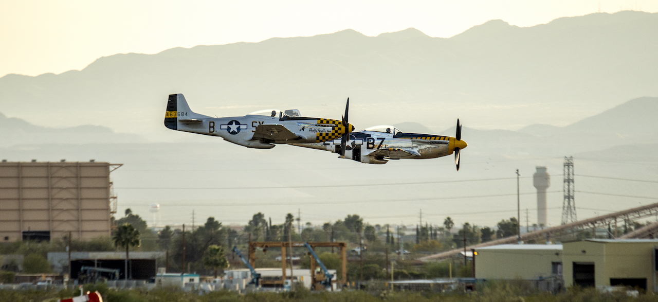 Two P-51D Mustangs that were among the vintage fighter aircraft participating in the Heritage Flight Training Course at Davis-Monthan AFB, Tucson, Ariz., Mar 3, 2016, make a low pass in formation over the airfield . (U.S. Air Force photo by J.M. Eddins Jr.)