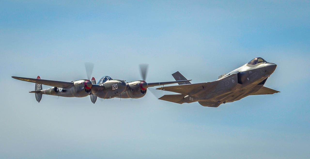 An F-38 Lightening and an F-35 Lightening II fly around the airspace of Davis-Monthan Air Force Base on March 4, 2016. The F-38 and the F-35 participated in Air Combat Command's Heritage Flight Training Course, a program that features modern fighter/attack aircraft flying alongside Word War II, Korean War, and Vietnam War-era aircraft. (U.S. Air Force photo by Tech. Sgt. Brandon Shapiro)