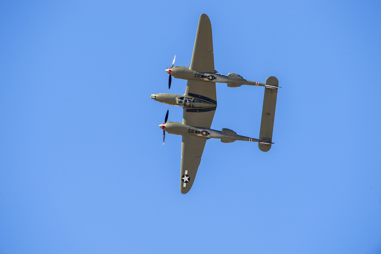 A P-38 Lightning performs a barrel roll at the finale of a formation practice flight during the Heritage Flight Training Course at Davis-Monthan AFB, Tucson, Ariz., Mar 5, 2016. (U.S. Air Force photo by J.M. Eddins Jr.)