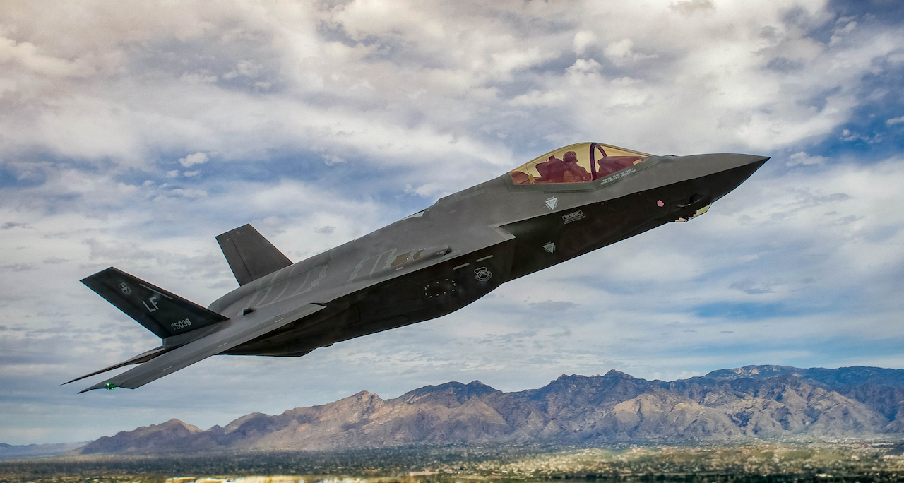 An F-35 Lightening II flies around the airspace of Davis-Monthan Air Force Base on March 5, 2016. The F-35 was participating in Air Combat Command's Heritage Flight Training Course, a program that features modern fighter/attack aircraft flying alongside Word War II, Korean War, and Vietnam War-era aircraft. (U.S. Air Force photo by Tech. Sgt. Brandon Shapiro)