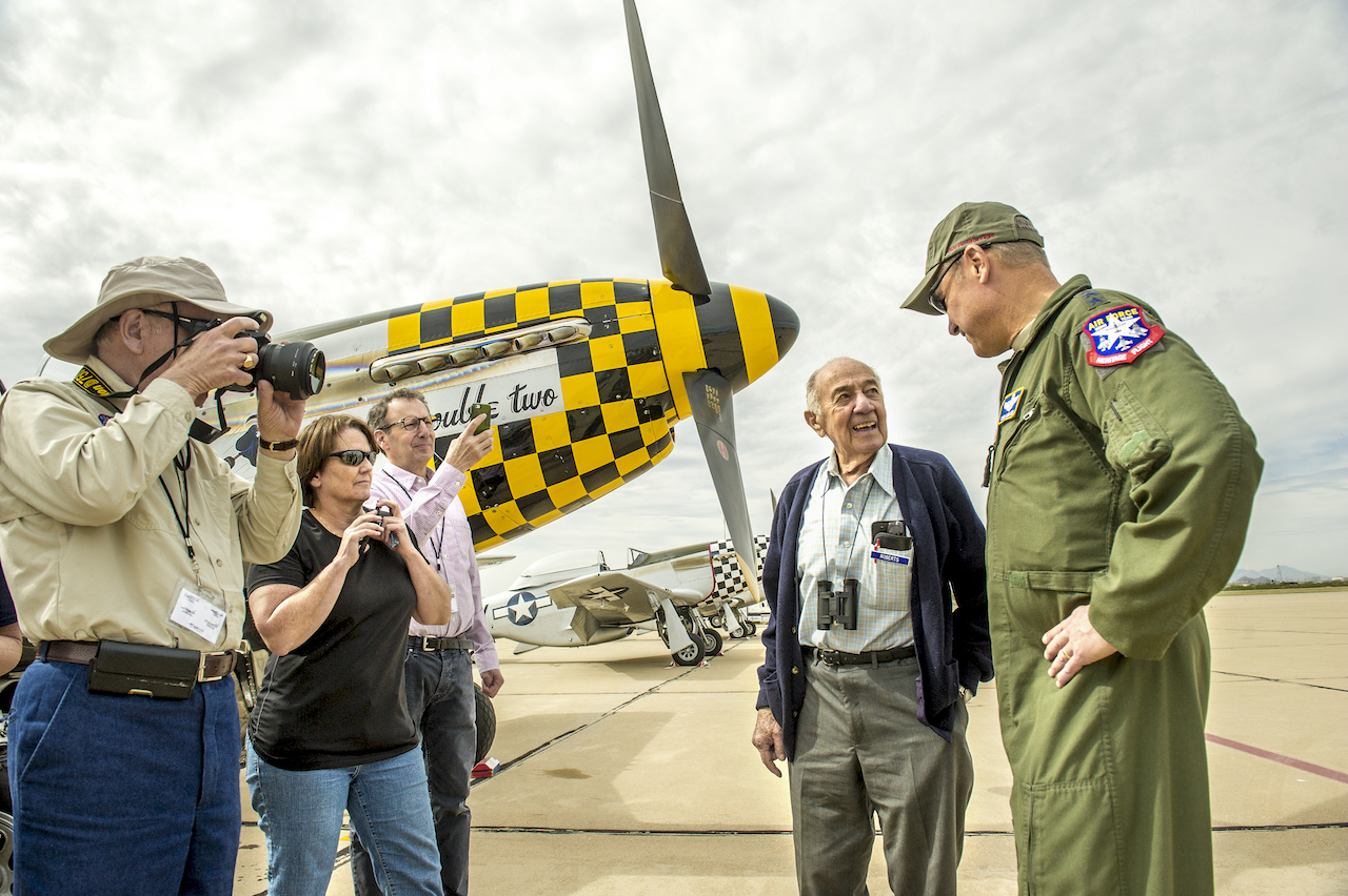 "Fred Roberts, 93, second from right, a former P-51D pilot during WWII with the 354th Fighter Squadron, 355th Fighter Group in England, talks with Lt. Gen. Mark C. ""Chris"" Nowland, Commander, 12th Air Force, Air Combat Command, and Commander, Air Forces Southern, U.S. Southern Command, Davis-Monthan Air Force Base, Ariz. during the Heritage Flight Training Course at Davis-Monthan AFB, Tucson, Ariz., Mar 6, 2016. Roberts was tasked with destroying 57 P-51s after the cease of hostilities in Europe; including one of the planes he flew in combat. (U.S. Air Force photo by J.M. Eddins Jr.)"