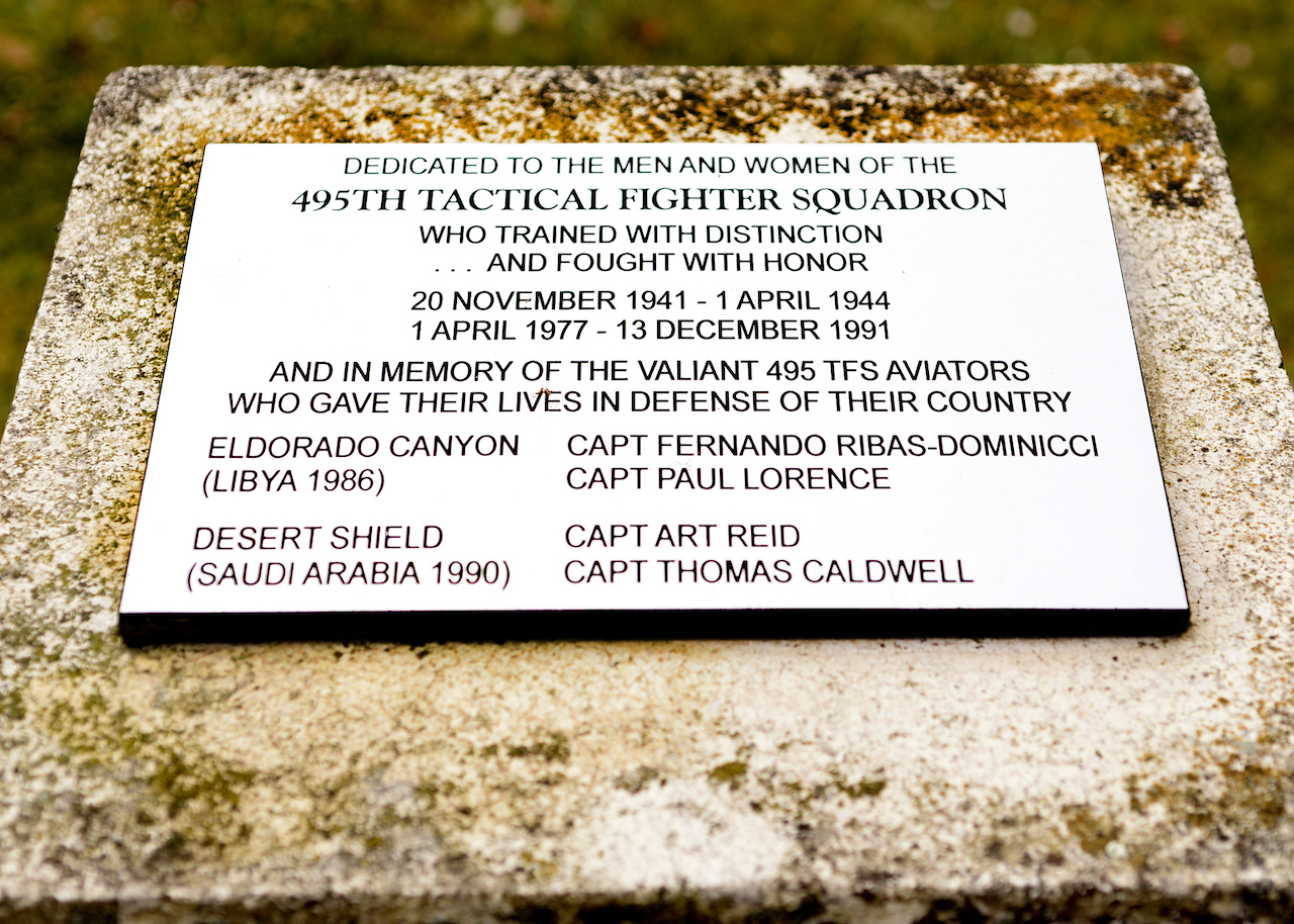 A monument dedicated to the men and women of the 495th Tactical Fighter Squadron was placed across from the 48th medical group at Royal Air Force Lakenheath, England, Dec. 13, 1991. Inscribed on the plaque are the names of Captains Ribas-Dominicci and Lorence's in memory of their service and sacrifice during Operation El Dorado Canyon. (U.S. Air Force photo/Tech. Sgt. Matthew Plew)
