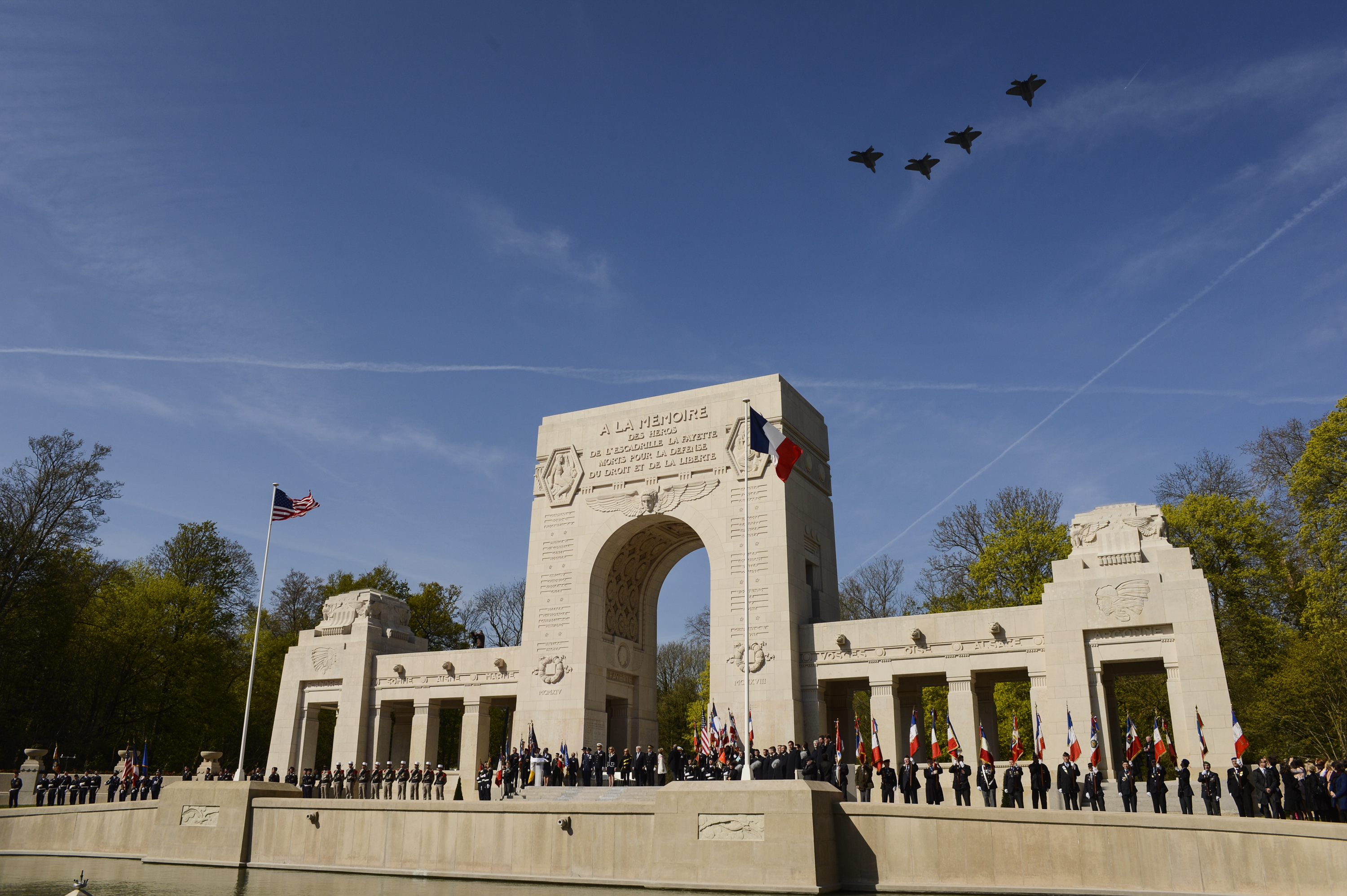 Four U.S. Air Force F-22 Raptor fifth generation fighters fly over the Lafayette Escadrille Memorial in Marnes-la-Coquette, France, April 20, 2016, during a ceremony honoring the 268 Americans who joined the French Air Force before the U.S. officially engaged in World War I. In addition to the F-22s, a USAF B-52 Stratofortress bomber, three FAF Mirage 2000Ns, one FAF Rafale and a World War I-era Stearman PT-17 biplane performed flyovers during the ceremony commemorating the 100th anniversary of the Layfette Escadrille's formation. Men of the Lafayette Escadrille and Lafayette Flying Crops were critical to the formation of the U.S. Air Force. (U.S. Air Force Photo by Tech. Sgt. Joshua DeMotts/Released)