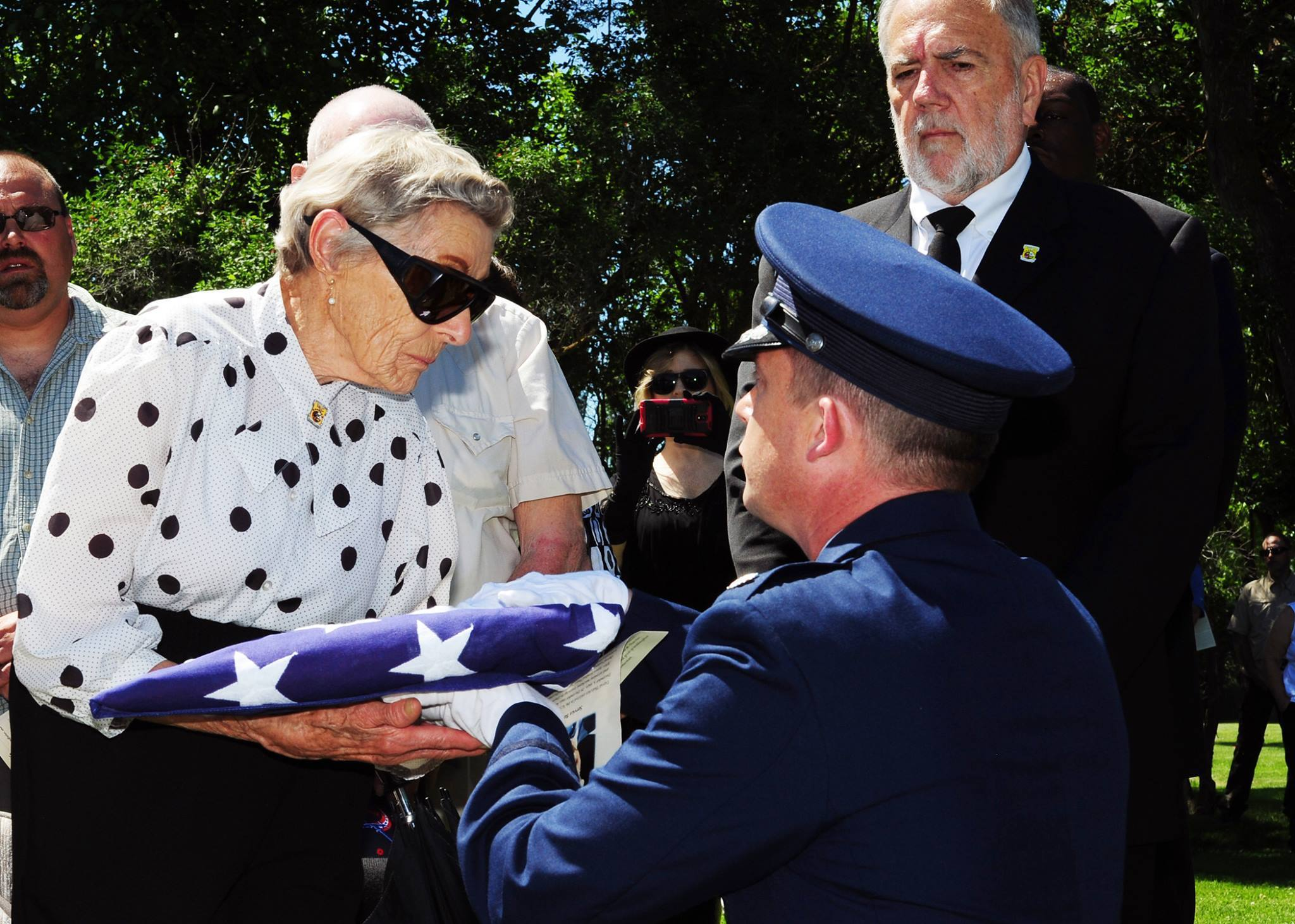 Lt. Col. Michael Epper, 341st Force Support Squadron commander, presents the flag to Dawn Thatcher, wife of Staff Sgt. David J. Thatcher, during a funeral service June 27 in Missoula, Mont. At 20 years old, Sgt. Thatcher was an engineer gunner in Flight Crew 7 of the Doolittle Tokyo Raids. His crew crash-landed into sea off the coast of China on April 18, 1942. Thatcher saved four members of the crew by pulling them to safety on the surrounding beach and applying life-saving medical treatment, even though he was injured himself. (U.S. Air Force photo by 2nd Lt. Annabel Monroe)