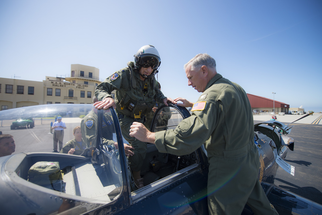 "Retired Cmdr. Dean ""Diz"" Laird walks into the rear seat of a T-34C Turbomentor with the ""Flying Eagles"" of Strike Fighter Squadron (VFA) 122. The T-34C marks the 100th aircraft Laird has flown in his 95-year lifetime. (U.S. Navy photo by Mass Communication Specialist 2nd Class Paolo Bayas/Released)"