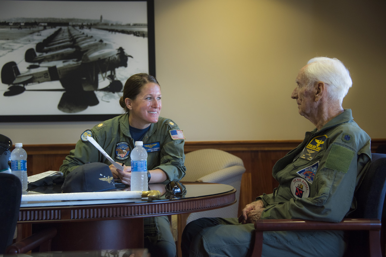 "Retired Cmdr. Dean ""Diz"" Laird, right, and Lt. Cmdr. Nicole Johnson, a pilot instructor with the ""Flying Eagles"" of Strike Fighter Squadron (VFA) 122, conduct a flight brief for a T-34C Turbomentor. The T-34C marks the 100th aircraft Laird has flown in his 95-year lifetime. (U.S. Navy photo by Mass Communication Specialist 2nd Class Paolo Bayas/Released)"