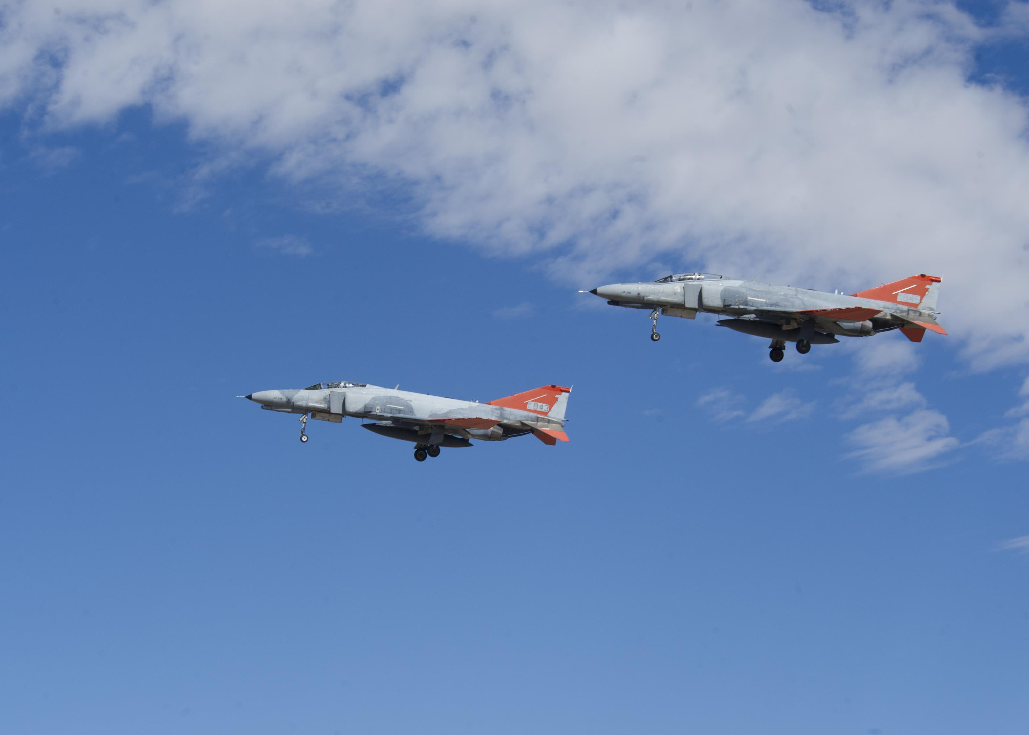 Two QF-4 Phantom IIs fly in formation over Holloman Air Force Base, N.M. on Sept. 13, 2016, in front of 160 spectators participating in Holloman's annual Phantom Society Tour. The tour enabled aircraft enthusiasts, including veterans and non-veterans with aviation backgrounds, to learn more about Holloman AFB's aircraft and mission. The tour included an F-16 Fighting Falcon static display and briefing, travel to Holloman's High Speed Test Track, the opportunity to view QF-4 Phantom IIs and F-16s in flight, and a visit to the base's heritage park to view static displays of various aircraft historically stationed at Holloman AFB. (U.S. Air Force photo by Master Sgt. Matthew McGovern)