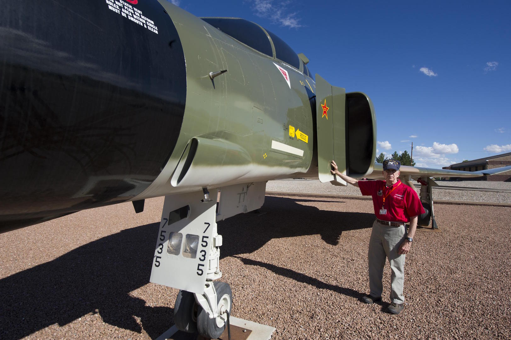 Col. (Ret.) Joe Latham, previously an F-4 Phantom pilot from Holloman Air Force Base, N.M., stops Sept. 13, 2016, to reminisce next to the F-4 adorned with his name Sept. 13, 2016, at Holloman AFB's Heritage Park. Latham's visit was part of Holloman's annual Phantom Society Tour where 160 aircraft enthusiasts, including veterans and non-veterans with aviation backgrounds, visit various base locations. The tour included an F-16 Fighting Falcon briefing and static display, travel to Holloman's High Speed Test Track, the opportunity to view QF-4s and F-16s in flight, and a visit to Heritage Park to view displays of various aircraft historically stationed at Holloman AFB. (U.S. Air Force photo by Master Sgt. Matthew McGovern)
