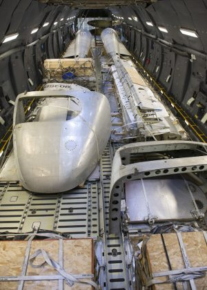 "Portions of the Fairchild C-119B Flying Boxcar #48-0352 ""Am Can Co Special"" sit inside a C-5M Super Galaxy's cargo bay during a mission to bring it to the Air Mobility Command Museum Dec. 19, 2016, at Edwards Air Force Base, Calif. These aircraft portions weighed around 23,000 pounds. (U.S. Air Force photo by Senior Airman Zachary Cacicia)"
