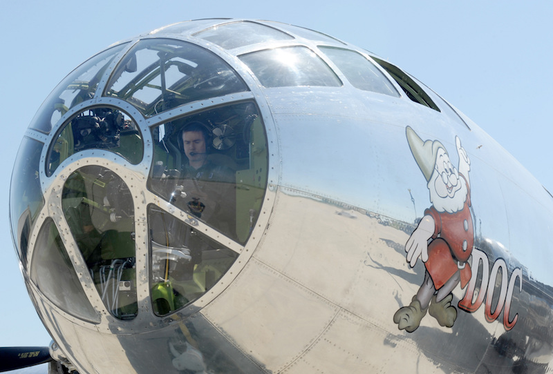 Brig. Gen. Paul Tibbets IV, 509th Bomb Wing commander, Whiteman Air Force Base, Mo., conducts pre-flight checks on Doc, a restored B-29 Superfortress, June 9, 2017, on McConnell Air Force Base, Kan. Tibbets' grandfather, retired Brig. Gen. Paul Tibbets Jr., piloted the 'Enola Gay,' during WWII and dropped the world's first atomic bomb used in warfare. (U.S. Air Force photo/Senior Airman Tara Fadenrecht)