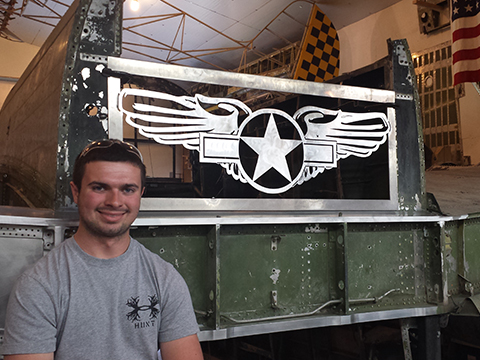 "Tyler, one of the museum's youth volunteers, drew up the ""Warbirds Of Glory"" logo in a CAD package and then sawed it from aluminum sheet using the water jet cutter at his school. Tyler then donated it to the museum, and it looks great up against the B-25's fuselage."
