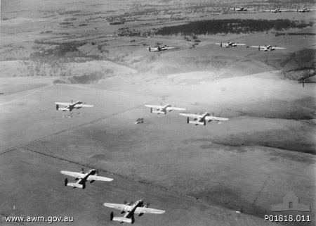 Dutch B-25 Mitchells and crews operating as RAAF (NEI) 18 Squadron on a training flight near Canberra, Australia in 1942. (photo via Wikipedia)