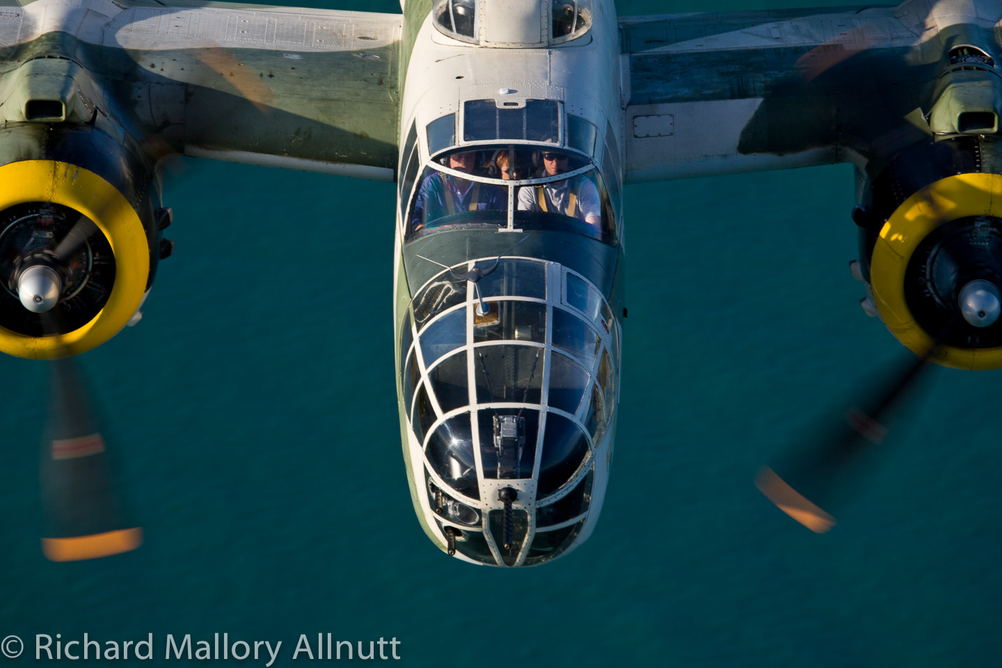 "Tom Reilly at the controls of his B-25J ""Killer B"" over the Florida coast. (photo by Richard Mallory Allnutt)"