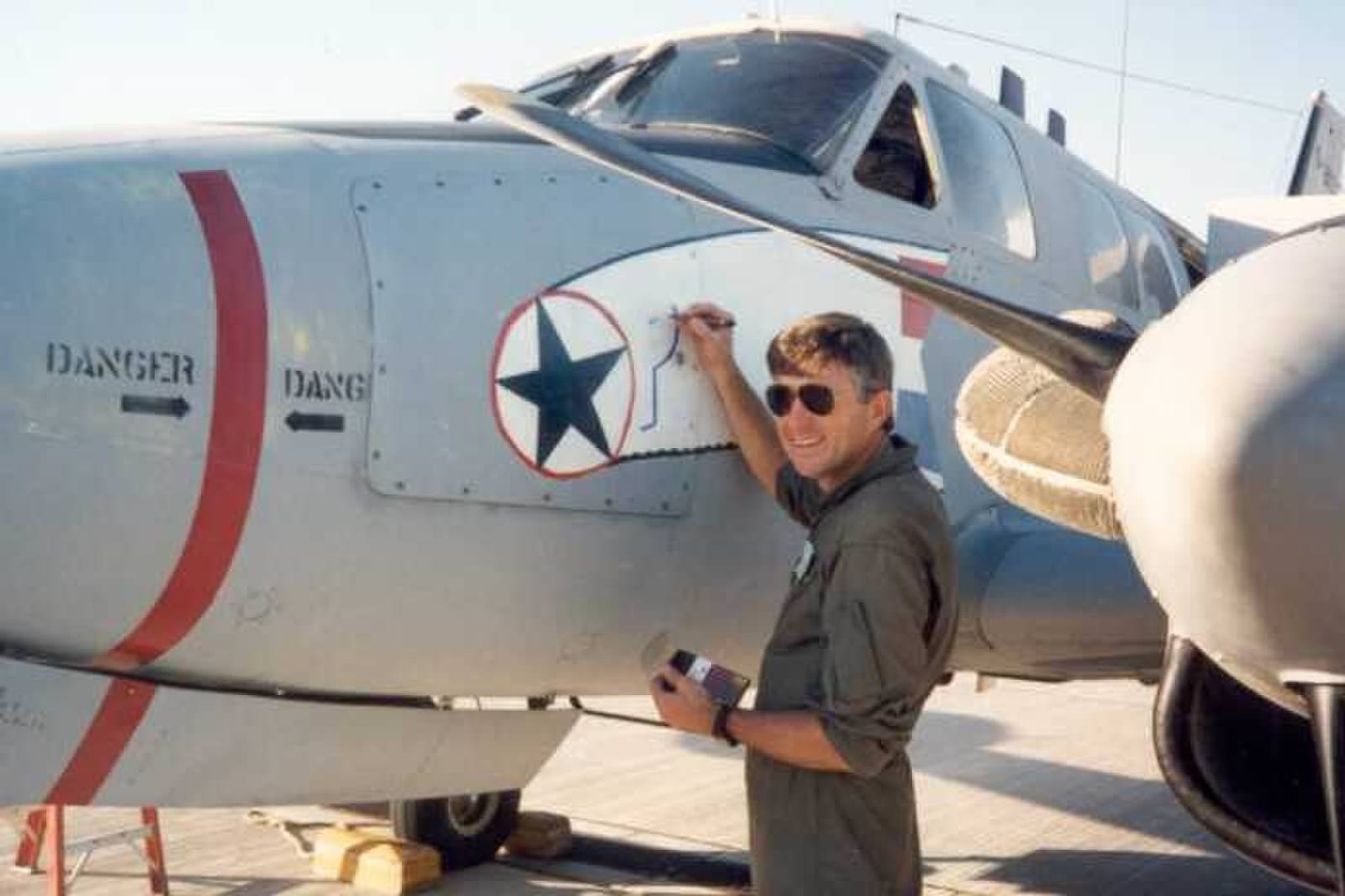One of the 1990 aircrew painting on the nose art prior to the aircraft's ferry flight to Saudi Arabia for Operation Desert Storm. (photo via Andrew Rodriguez)