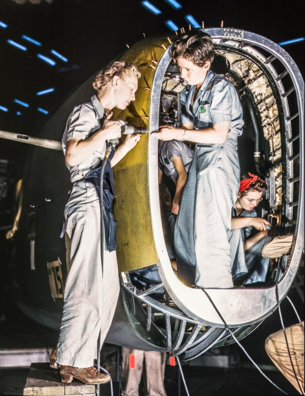 Riveters at work on fuselage of Liberator Bomber, Consolidated Aircraft Corp., Fort Worth, Texas. (photo by Howard R. Hollem)