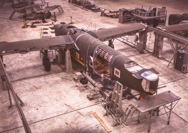 A mating operation on a transport plane just before it comes to the pre-assembly line at the Consolidated Aircraft Corporation plant, Fort Worth, Texas. (Howard R. Hollem photo)