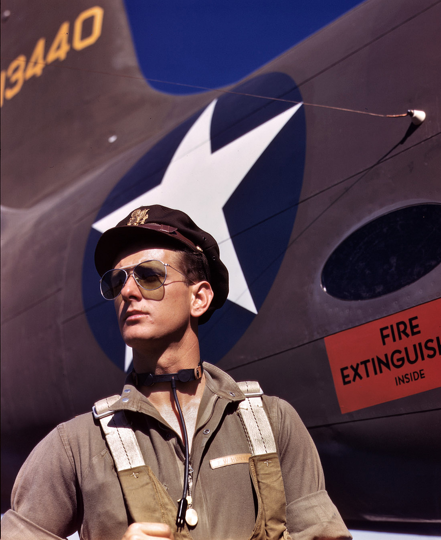 This October 1942 Palmer photograph shows a pilot assigned to the Douglas Aircraft Company, Long Beach, California. Note the dramatic upward gaze of the subject. I would guess that this pilot was a ferry pilot, delivering aircraft to the Army from the Douglas factory.