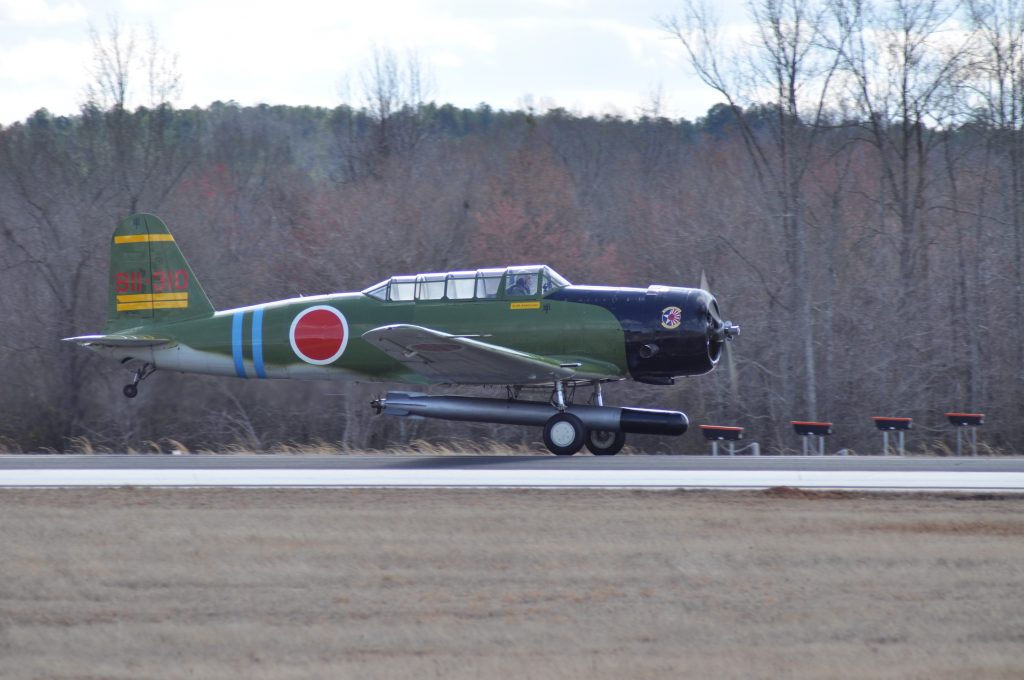 "1943 SNJ-4 ""Kate"" bomber taking off from Falcon field in Peachtree City, GA."