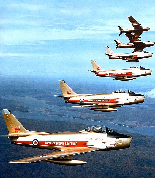 Pilots for the Golden Hawks flight demonstration team were selected from the Sabre Operational Training Unit at CFB Chatham and each had had operational experience with the Air Division. They practiced three times daily for two-and-a-half months before putting on their initial display at Torbay, Newfoundland, the first of 63 shows across the country in 1959.